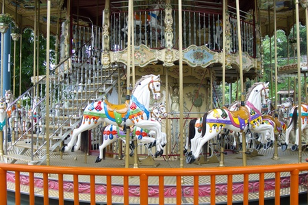 Childhood memories with carousel in a park photo