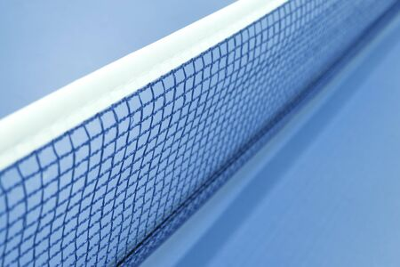 focus view of table tennis net indoors in blue color photo