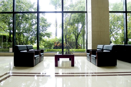 beautiful black modern sofa indoors in public lobby of a building Stock Photo