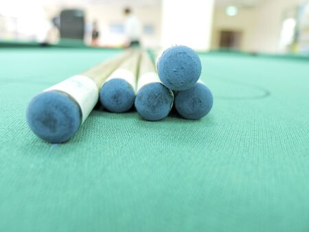 cue sticks: cue sticks on green table indoors