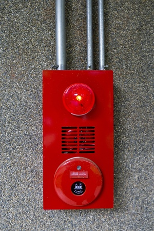Fire alarm bell on wall in a public place photo