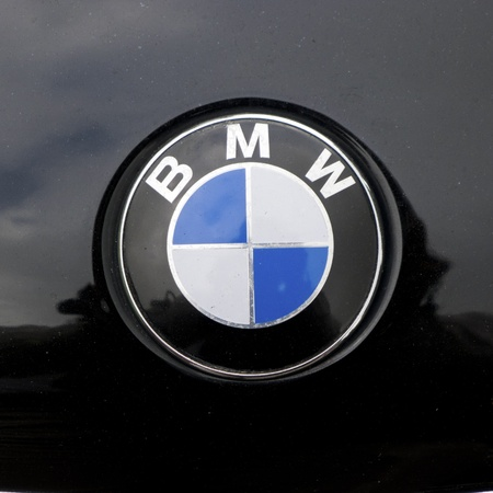 bmw sign on car mixed with black