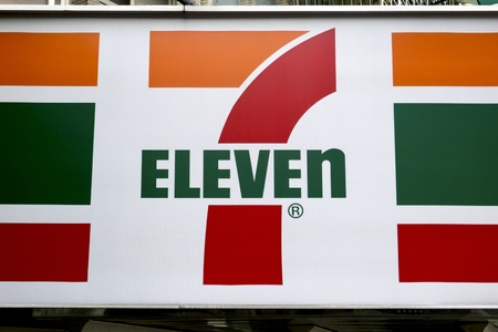 convenient store: seven eleven sign with colorful text