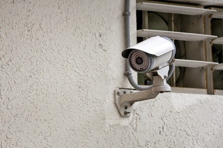 security camera on wall in public space Stock Photo - 13055111