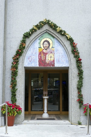 decorated door to the Gothic church photo