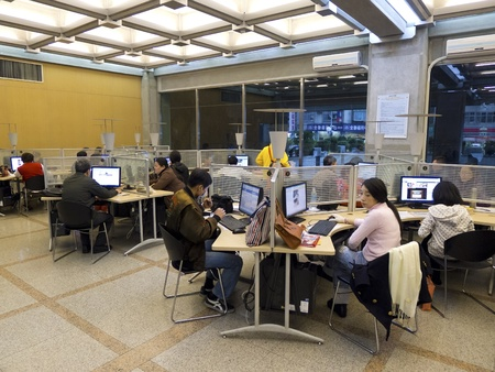 people on internet with computers in a public lobby