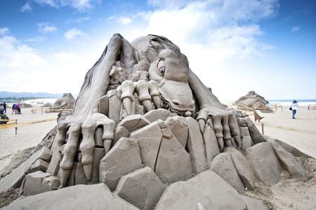FULONG, TAIWAN-MAY 23,2012:a dinosaur sand sculpture at Fulong beach for celebrating the Sand Sculpture Festival on May 23,2012 in Fulong,Taiwan Stock Photo - 14149278