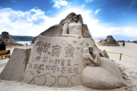 teng: FULONG, TAIWAN-MAY 23,2012:a singer teng sand sculpture at Fulong beach for celebrating the Sand Sculpture Festival on May 23,2012 in Fulong,Taiwan