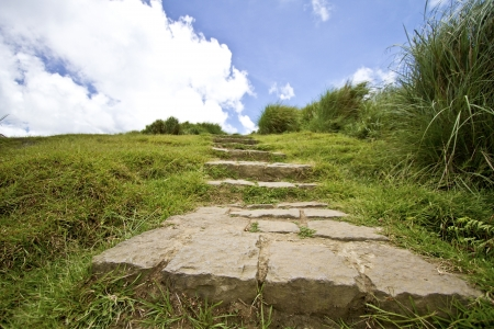 Narrow trail ascending the side of a hill, Taiwan photo