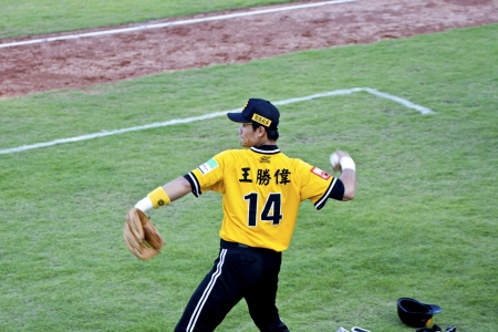 Tianmu, Taiwan - September 1,2012 : Wang, a Brother Elephants player of CPBL, warm up for the Chinese Professional Baseball League game on September 1, 2012 at Tianmu Stadium, Taipei, Taiwan. Stock Photo - 15156477