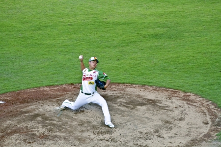 Tianmu, Taiwan - September 1,2012 : Lin, a Sinon Bulls player of CPBL, pitch for the Chinese Professional Baseball League game on September 1, 2012 at Tianmu Stadium, Taipei, Taiwan.