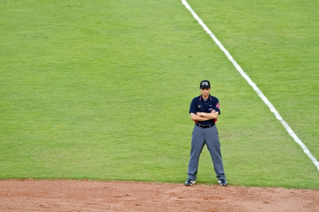 Tianmu, Taiwan - September 1,2012 : a baseball referee of CPBL, works for the Chinese Professional Baseball League game on September 1, 2012 at Tianmu Stadium, Taipei, Taiwan. Stock Photo - 15156504