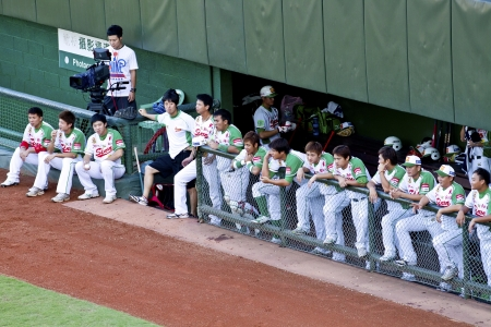 Tianmu, Taiwan - September 1,2012 : Sinon Bulls players of CPBL, watching for the Chinese Professional Baseball League game at rest area on September 1, 2012 at Tianmu Stadium, Taipei, Taiwan.