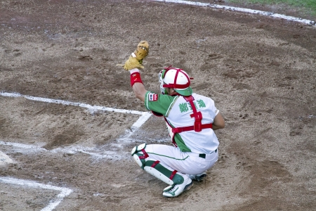Tianmu, Taiwan - September 1,2012 : Tseng, a Sinon Buls catcher of CPBL, play for the Chinese Professional Baseball League game on September 1, 2012 at Tianmu Stadium, Taipei, Taiwan. Stock Photo - 15156522