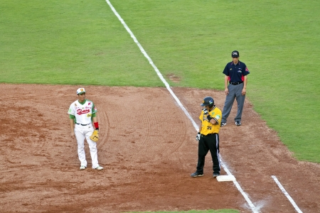 Tianmu, Taiwan - September 1,2012 : Chang, a Brother Elephants player of CPBL, get on first base for the Chinese Professional Baseball League game on September 1, 2012 at Tianmu Stadium, Taipei, Taiwan.