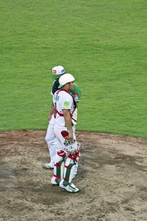 Tianmu, Taiwan - September 1,2012 : Tseng, a Sinon Buls catcher of CPBL, talk to the pitcher for the Chinese Professional Baseball League game on September 1, 2012 at Tianmu Stadium, Taipei, Taiwan.