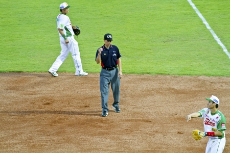 Tianmu, Taiwan - September 1,2012 :  a referee of CPBL, judge out for the Chinese Professional Baseball League game on September 1, 2012 at Tianmu Stadium, Taipei, Taiwan.