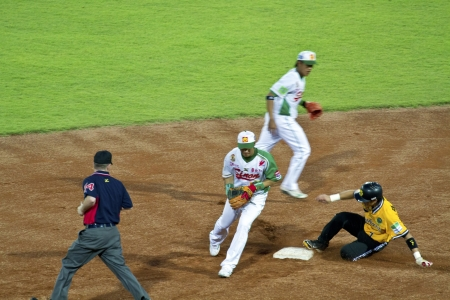 Tianmu, Taiwan - September 1,2012 : Chang, a Brother Elephants player of CPBL, slide to second base for the Chinese Professional Baseball League game on September 1, 2012 at Tianmu Stadium, Taipei, Taiwan.