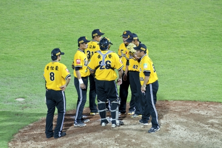 Tianmu, Taiwan - September 1,2012 : Brother Elephants players of CPBL, call time on pitcher hill for the Chinese Professional Baseball League game on September 1, 2012 at Tianmu Stadium, Taipei, Taiwan.