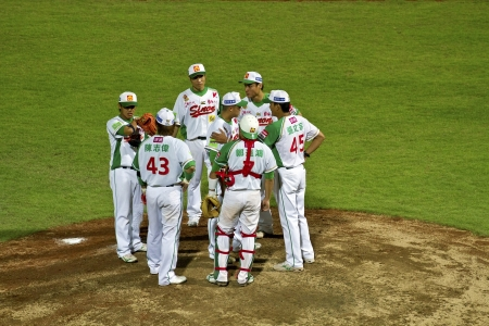 Tianmu, Taiwan - September 1,2012 : Sinon Bulls players of CPBL, call time on pitcher hill for the Chinese Professional Baseball League game on September 1, 2012 at Tianmu Stadium, Taipei, Taiwan.