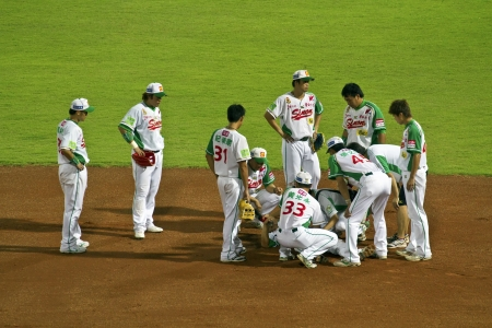 Tianmu, Taiwan - September 1,2012 : Wang, a Sinon Bulls player of CPBL, get hurt for the Chinese Professional Baseball League game on September 1, 2012 at Tianmu Stadium, Taipei, Taiwan.