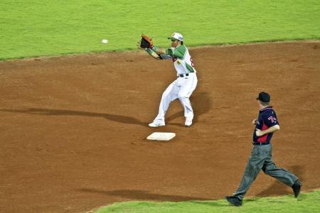Tianmu, Taiwan - September 1,2012 : Tseng, a Sinon Bulls player of CPBL, catch the baseball at second base for the Chinese Professional Baseball League game on September 1, 2012 at Tianmu Stadium, Taipei, Taiwan.
