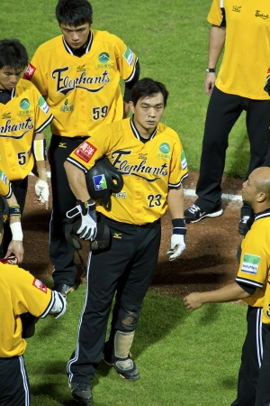 Tianmu, Taiwan - September 1,2012 : Peng, a Brother Elephants player of CPBL, waiting bats for the Chinese Professional Baseball League game on September 1, 2012 at Tianmu Stadium, Taipei, Taiwan. Stock Photo - 15156491