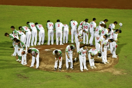 Tianmu, Taiwan - September 1,2012 :  Sinon Bulls players of CPBL,bow to the  spectators for the Chinese Professional Baseball League game on September 1, 2012 at Tianmu Stadium, Taipei, Taiwan.
