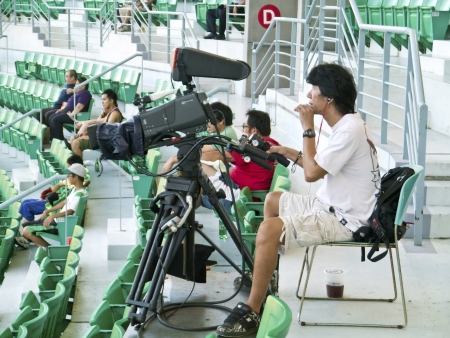 Tianmu, Taiwan - September 1,2012 : a camera man record of Sinon Bull vs Brother Elephant for the Chinese Professional Baseball League game on September 1, 2012 at Tianmu Stadium, Taipei, Taiwan.