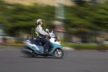TAIPEI,TAIWAN -October 20,2012:Unidentified policeman of Taiwan riding motorcycle - doing the traffic control for street parade of celebrating Mardi Gras of Christian on October 20,2012 in Taipei,Taiwan .