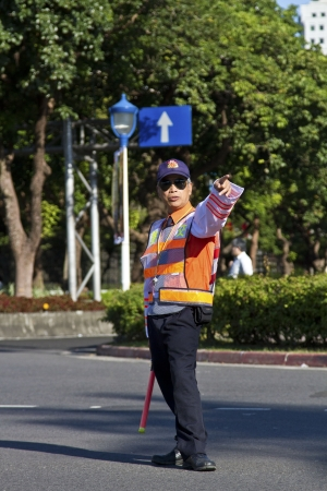 TAIPEI,TAIWAN -October 20,2012:Unidentified vigilante of Taiwan riding motorcycle - doing the traffic control for street parade of celebrating Mardi Gras of Christian on October 20,2012 in Taipei,Taiwan .