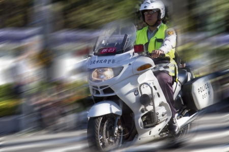 TAIPEI,TAIWAN -October 20,2012:Unidentified policeman of Taiwan riding motorcycle - doing the traffic control for street parade of