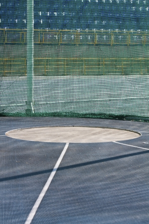 Area for hammer throwing on the athletics field with net