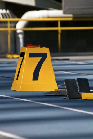 Closeup of starting block on running track of lane seven photo