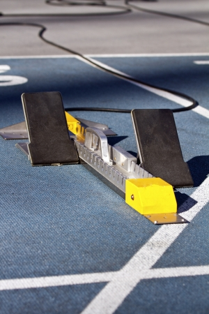 Closeup of starting block on running track photo