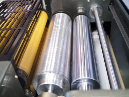 prepress: Closeup of printng machine working part with white light