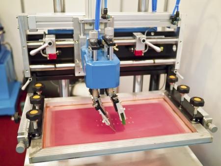 Closeup of printing machine working part with white light