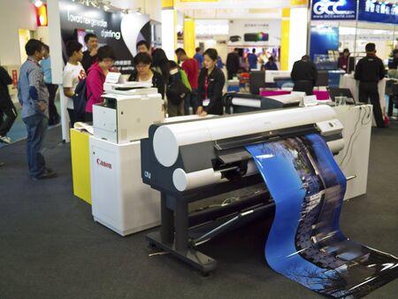 TAIPEI,TAIWAN -October 21,2012:various printing machines reveal in the Taipei International Printing Machine Exhibition on October 21,2012 in Taipei,Taiwan . Stock Photo - 16206036
