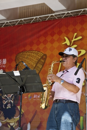 tradional: NEW TAIPEI CITY,TAIWAN -November 3,2012:saxophone performance in LuZhou elementary School for celebrating the Taiwanese Traditional Art Festival on November 3,2012 in New Taipei City,Taiwan .