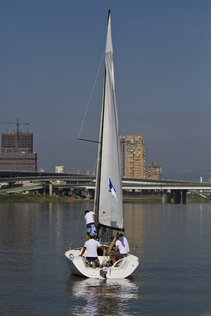 keel: TAIPEI,TAIWAN -November 10,2012:Keel Boat Sailing on river in 2012 Taipei Keel Boat Competition in Dadaocheng Wharf on November 10,2012 in Taipei,Taiwan