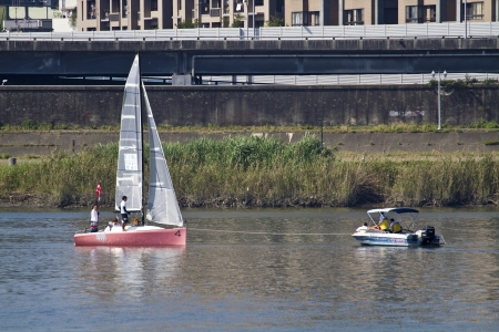 TAIPEI,TAIWAN -November 10,2012:Keel Boat Sailing on river in 2012 Taipei Keel Boat Competition in Dadaocheng Wharf on November 10,2012 in Taipei,Taiwan Stock Photo - 16309999