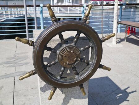 old wooden ships helm wheel photo