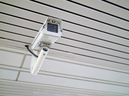security camera on wall in public space indoor Stock Photo - 16428625