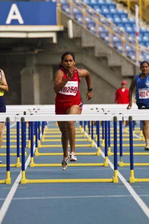 senior olympics: TAIPEI,TAIWAN -November 4,2012:80m hurdles woman athlete in 17th Asia Master Athletics Championships in Taipei stadium on November 4,2012 in Taipei,Taiwan Editorial