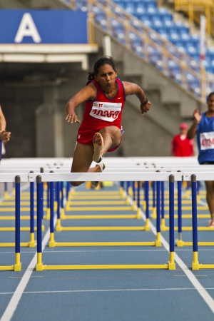 TAIPEI,TAIWAN -November 4,2012:80m hurdles woman athlete in 17th Asia Master Athletics Championships in Taipei stadium on November 4,2012 in Taipei,Taiwan