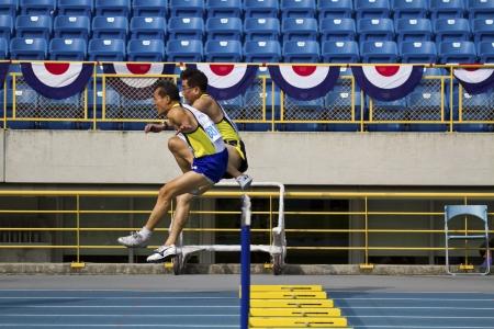 senior olympics: TAIPEI,TAIWAN -November 4,2012:100m man hurdles athlete in 17th Asia Master Athletics Championships in Taipei stadium on November 4,2012 in Taipei,Taiwan Editorial