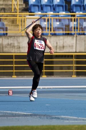 senior olympics: TAIPEI,TAIWAN -November 4,2012:woman javelin throw athlete in 17th Asia Master  Athletics Championships in Taipei stadium on November 4,2012 in Taipei,Taiwan
