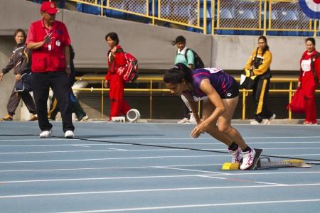 senior olympics: TAIPEI,TAIWAN -November 4,2012:400m woman athlete in 17th Asia Master Athletics Championships in Taipei stadium on November 4,2012 in Taipei,Taiwan