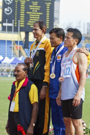 senior olympics: TAIPEI,TAIWAN -November 4,2012:athletes of medalists in 17th Asia Master Athletics Championships in Taipei stadium on November 4,2012 in Taipei,Taiwan