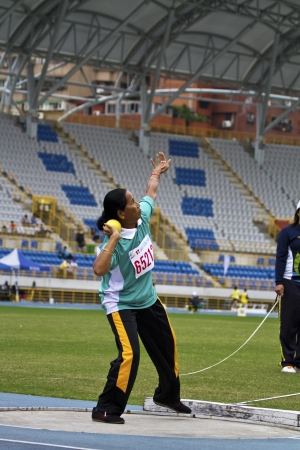 senior olympics: TAIPEI,TAIWAN -November 6,2012:woman shot-put athlete in 17th ASia Master Athletics Championships in Taipei stadium on November 6,2012 in Taipei,Taiwan Editorial